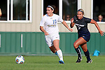 BROOKINGS, SD - August 19:  Nicole Hatcher #10 from South Dakota State pushes the ball past Danielle Nowers #7 from Utah State during the first half of their match at Fischback Soccer Field in Brookings. (Photo by Dave Eggen/Inertia)
