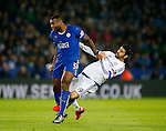 Wes Morgan of Leicester City and Diego Costa of Chelsea clash early in the game - English Premier League - Leicester City vs Chelsea - King Power Stadium - Leicester - England - 14th December 2015 - Picture Simon Bellis/Sportimage