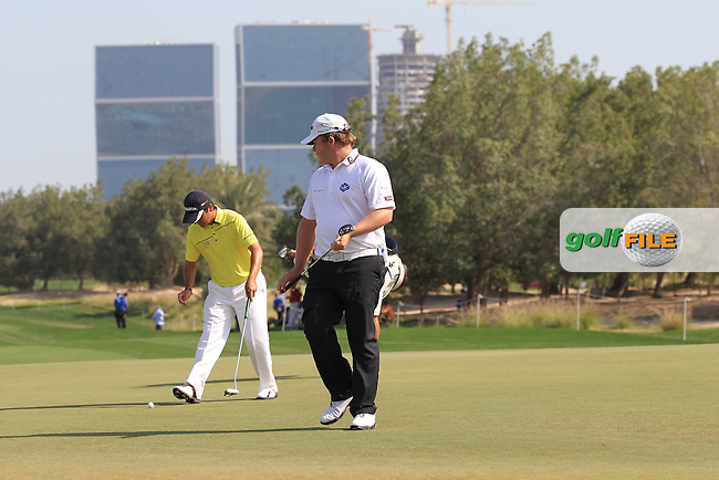 George Coetzee (RSA) and Felipe Aguilar (CHI) on the 5th green during Friday's Round 3 of the Commercial Bank Qatar Masters 2013 at Doha Golf Club, Doha, Qatar 25th January 2013 .Photo Eoin Clarke/www.golffile.ie