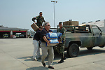 Haley Barbour, Governor of Misssissippi is seen carrying a case of water  from a helicopter in gulfport to a trransport truck on the way to Bay St. Louis Mississippi Sunday Sept. 4,2005 The governor went to Bat St. Louis high School  where a shelter was set up in their gym and distributed supplies and water to the refugees..(photo/Suzi Altman)
