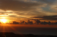 Sun rays breaking through the clouds at dawn over the Atlantic.. Tenerife, Canary Islands,