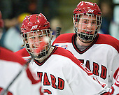 Alex Fallstrom (Harvard - 16) and Dan Ford (Harvard - 5) celebrate after Fallstrom's tying goal. - The visiting Cornell University Big Red defeated the Harvard University Crimson 2-1 on Saturday, January 29, 2011, at Bright Hockey Center in Cambridge, Massachusetts.