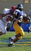 Eagle safety Gregor Smith attempts to tackle Spartan tailback Yonus Davis in a game at Spartan Stadium on Saturday, September 3, 2005.  San Jose State University beat Eastern Washington University 35-24.