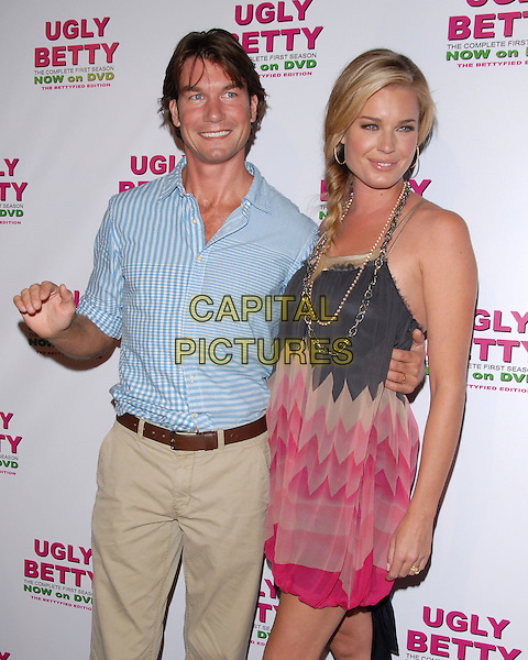 JERRY O'CONNELL & REBECCA ROMIJN O'CONNELL.at The Ugly Betty: The Complete First Season - The Bettyfied Edition DVD Launch Event held at Skybar in West Hollywood, California, USA, August 20th 2007.                                                                     half length plaits hair braids necklace pink pattern dress zigzag .CAP/DVS.©Debbie VanStory/Capital Pictures