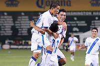 Guatemala defender Jose Luis Hidalgo (11) celebrates his goal with team mates.   The Guatemalan National Team defeated  El Salvador National Team 2-0 in a friendly international at RFK Stadium, Saturday September 7, 2010.