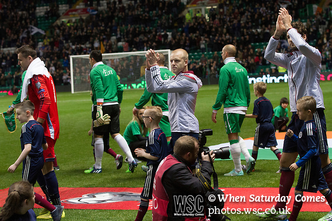 Scotland 1 Republic of Ireland 0, 14/11/2014. Celtic Park, European Championship qualifying. Home striker Steven Naismith applauding fans as he walks onto the pitch before the European Championship qualifying match between Scotland and the Republic of Ireland at Celtic Park, Glasgow. Scotland won the match by one goal to nil, scored by Shaun Maloney 16 minutes from time. The match was watched by 55,000 at Celtic Park, the venue chosen to host the match due to Hampden Park's unavailability following the 2014 Commonwealth Games. Photo by Colin McPherson.