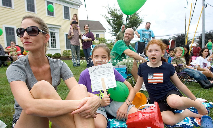 NEWTOWN CT. 02 September 2013-090213SV05-From left, Susan Torres, her daughter, Mya Torres, 10 and Amanda Colonel, 9 all of Sandy Hook enjoy the 52nd Labor Day Parade in Newtown Monday.  The theme for this year&rsquo;s parade was &ldquo;We are Newtown&mdash;Marching Strong&rdquo;<br /> Steven Valenti Republican-American