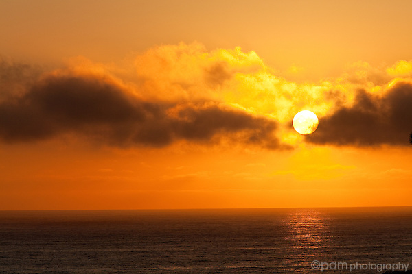 Orange sunset over the ocean on the California coast