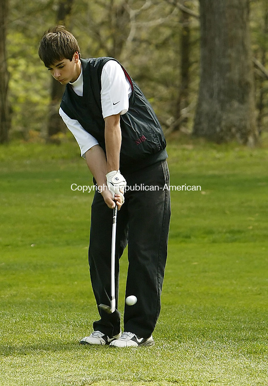 NAUGATUCK, CT, 04/30/09- 043009BZ08- Naugatuck's Aaron Johnson chips to the second green during a match against Watertown at Hop Brook Thursday.<br />  Jamison C. Bazinet Republican-American