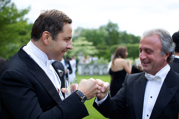 David Walliams and Raffy Manoukian bump fists at The Elton John White Tie and Tiara Ball