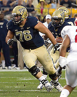Ryan Schlieper (76) of Pitt blocks for running back Ray Graham. The Youngstown St. Penguins defeated the Pittsburgh Panthers 31-17 on Saturday, September 1, 2012 at Heinz Field in Pittsburgh, PA.
