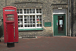 Small branch library with red phone box and pillar box, Leiston, Suffolk, England