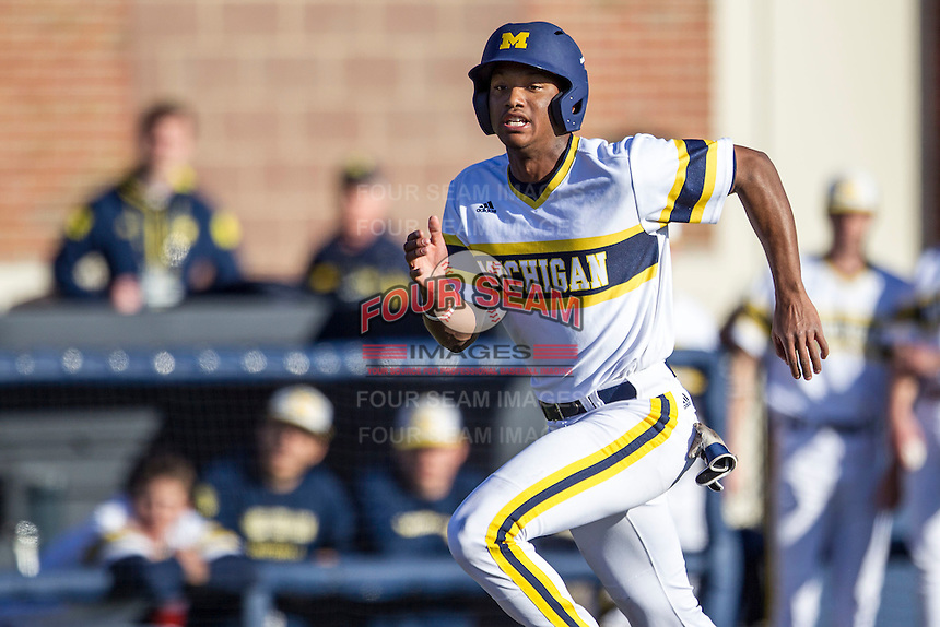 Michigan Wolverines outfielder Johnny Slater (25) sprints home against the Central Michigan Chippewas on March 29, 2016 at Ray Fisher Stadium in Ann Arbor, Michigan. Michigan defeated Central Michigan 9-7. (Andrew Woolley/Four Seam Images)
