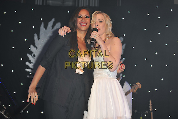 Natasha Bedingfield and Leona Lewis.'Global Angels Awards', The Park Plaza Hotel, Westminster, London, England. 2nd December 2011..music on stage live concert gig performing half length microphone singing strapless white dress black jacket hand arm duet around .CAP/MAR.© Martin Harris/Capital Pictures.