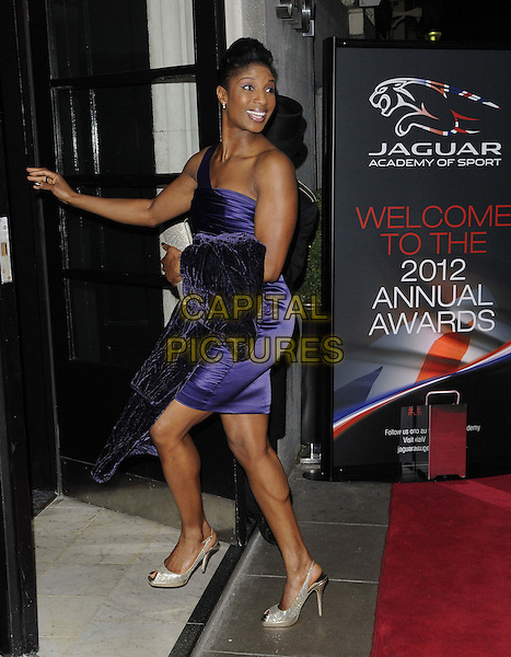 Denise Lewis.The Jaguar Academy of Sport Annual Awards 2012, Savoy Hotel, The Strand, London, England..December 2nd, 2012.full length purple dress ruched silk satin one shoulder beige shoes peep toe side hand arm.CAP/CAN.©Can Nguyen/Capital Pictures.