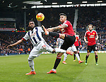Stephane Sessegnon of West Bromwich Albion tussles with Marcos Rojo of Manchester United - English Premier League - West Bromwich Albion vs Manchester Utd - The Hawthorns Stadium - West Bromwich - England - 6th March 2016 - Picture Simon Bellis/Sportimage