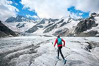 Trail running on the Unterer Grindelwaldgletscher while on the way to the Strahlegghorn, from Grindelwald, Switzerland