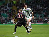 Charlie Mulgrew takes on Gary Teale in the Celtic v St Mirren Clydesdale Bank Scottish Premier League match played at Celtic Park, Glasgow on 15.12.12.