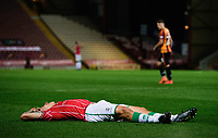 Lincoln City's Harry Anderson lays on the pitch requiring treatment for an injury<br /> <br /> Photographer Chris Vaughan/CameraSport<br /> <br /> Carabao Cup Second Round Northern Section - Bradford City v Lincoln City - Tuesday 15th September 2020 - Valley Parade - Bradford<br />  <br /> World Copyright © 2020 CameraSport. All rights reserved. 43 Linden Ave. Countesthorpe. Leicester. England. LE8 5PG - Tel: +44 (0) 116 277 4147 - admin@camerasport.com - www.camerasport.com