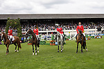 August 07, 2009: The US equestrian team stand for their national anthemn. Meydan FEI Nations Cup. Failte Ireland Horse Show. The RDS, Dublin, Ireland.