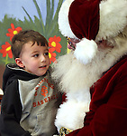 William Houk, 4, talks to Santa during Storytime at the Carson City Library on Thursday, Dec. 13, 2012. .Photo by Cathleen Allison