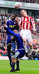 Glenn Whelan of Stoke City jumps with Bruno N'Gotty of Leicester City during the Championship League match at The Britannia Stadium, Stoke. Picture date 4th May 2008. Picture credit should read: Simon Bellis/Sportimage