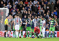 As Ki Sung-Yueng of Swansea City lies injured Darren Fletcher of West Bromwich Albion moans at the referee Neil Swarbrick during the Barclays Premier League match between West Bromwich Albion and Swansea City at The Hawthorns on the 2nd of February 2016