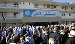 Palestinian Staff of Al-Ahli hospital take part in a protest outside al-Ahli Hospital in the West Bank city of Hebron 12 November 2015. Abdallah Shalaldeh was shot dead by Israeli special forces during a raid to arrest his cousin Azzam Shalaldeh. An undercover Israeli unit raided a southern West Bank hospital early 12 November, killing one Palestinian and seizing another, the Palestinian Health Ministry said. An Israeli military spokeswoman in Tel Aviv said that security forces had sought to apprehend a Palestinian accused of stabbing an Israeli outside a settlement bloc south of Jerusalem on 25 October 2015. The alleged Palestinian assailant, Azzam Shalaldeh, 20, had been shot by the Israeli victim. The Israeli was, in turn, severely injured with a stab wound to the chest. Photo by Wisam Hashlamoun