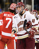 Tommy Cross (BC - 4) - The Boston College Eagles defeated the Boston University Terriers 3-2 (OT) in their Beanpot opener on Monday, February 7, 2011, at TD Garden in Boston, Massachusetts.