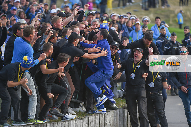 Rory McIlroy (Team Europe) jumps into a sea of groundkeepers to celebrate a Team Europe win following  Sunday's singles of the 2018 Ryder Cup, Le Golf National, Guyancourt, France. 9/30/2018.<br /> Picture: Golffile | Ken Murray<br /> <br /> <br /> All photo usage must carry mandatory copyright credit (© Golffile | Ken Murray)