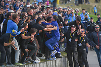 Rory McIlroy (Team Europe) jumps into a sea of groundkeepers to celebrate a Team Europe win following  Sunday's singles of the 2018 Ryder Cup, Le Golf National, Guyancourt, France. 9/30/2018.<br /> Picture: Golffile | Ken Murray<br /> <br /> <br /> All photo usage must carry mandatory copyright credit (&copy; Golffile | Ken Murray)