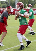 NWA Democrat-Gazette/DAVID GOTTSCHALK   Arkansas Razorback quarterback Austin Allen runs through drills Thursday, July 17, 2017, during practice on campus in Fayetteville.