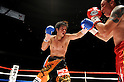 (L-R) Tomonobu Shimizu (JPN), Hugo Fidel Cazares (MEX), AUGUST 31, 2011 - Boxing : Tomonobu Shimizu of Japan in action against Hugo Fidel Cazares of Mexico during the WBA super flyweight title bout at Nippon Budokan in Tokyo, Japan. (Photo by Mikio Nakai/AFLO)