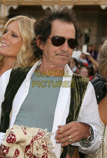 "PATTI HANSEN & KEITH RICHARDS  .""Pirates Of The Caribbean: At World's End"" World Premiere held at Disneyland, Anaheim, California, USA,.May 19th, 007.3 half family mustache facial hair aviator sunglasses shades  married husband wife skull scarf green waistcoat white shirt grey gray top .CAP/ADM/RE.©Russ Elliot/AdMedia/Capital Pictures"
