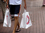 Man in shorts with shoppingbags