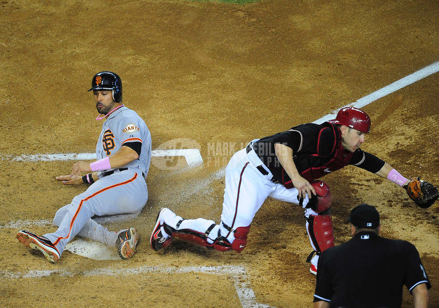 May 13, 2012; Phoenix, AZ, USA; Arizona Diamondbacks catcher Miguel Montero forces out San Francisco Giants base runner Angel Pagan (left) in the fourth inning at Chase Field. Mandatory Credit: Mark J. Rebilas-