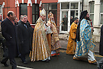 Greek community Uk. Margate Kent. Greek Orthodox Church of the Archangel Michael  L - R The Bishop of Dover Trevor Willmott, The Greek Archbishop Gregorios of Thyateira and Great Britain,  and the Very Revd. Archimandrite Vissarion Kokliotis, (in blue robes) process to the beach for the ceremony of The Blessing of the Sea, on  Epiphany 6th January.