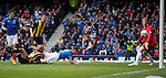 Fraser Aird heads in the opener for Rangers past Berwick keeper Marc McCallum