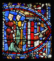 2 courtesans standing outside a house catch the eye of the younger son and invite him to join them, from the Parable of the Prodigal Son stained glass window, in the north transept of Chartres Cathedral, Eure-et-Loir, France. This window follows the parable as told by St Luke in his gospel. It is thought to have been donated by courtesans, who feature in 11 of the 30 sections. Chartres cathedral was built 1194-1250 and is a fine example of Gothic architecture. Most of its windows date from 1205-40 although a few earlier 12th century examples are also intact. It was declared a UNESCO World Heritage Site in 1979. Picture by Manuel Cohen