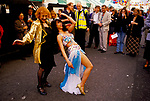 Ann Barr editor writer on &quot;Sloane Rangers&quot; dancing with belly dancer. Motcomb Street annual Street Party Belgravia London SW1 1998.<br />