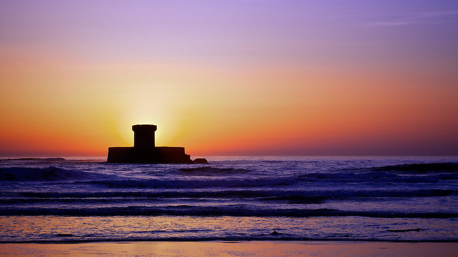The Sun Sets Behind La Rocco Tower, Jersey.