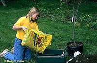 TT19-048z  Girl mixing fertilizer for planting tree - (TT19-004e,047z,048z,050z,051z,053z,056z,059z)