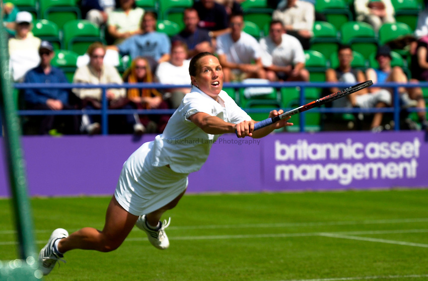 Photo. Rene Solari..19/6/01  .Eastbourne Day 2.  British Lucie Ahl dives for the ball as Australian Alicia Molik proves to be too good....
