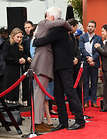 07 January 2019 - Hollywood, California - Bradley Cooper, Sam Elliott . Sam Elliott Hand And Footprint Ceremony held at TCL Chinese Theatre. Photo Credit: Birdie Thompson/AdMedia
