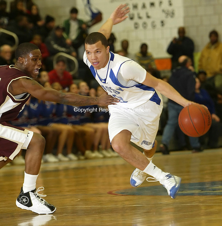 WATERBURY, CT, 02/04/08- 020409BZ13- Crosby's Anthony Ireland (3) drives against Sacred Heart's Terence Love (13) during their game Wednesday night.<br /> Jamison C. Bazinet Republican-American