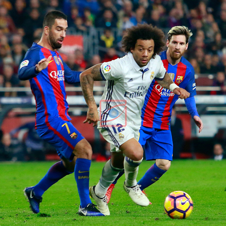 League Santander 2016/2017. Game: 14.<br /> FC Barcelona vs Real Madrid: 1-1.<br /> Arda Turan, Marcelo &amp; Lionel Messi.