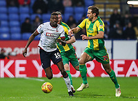 Bolton Wanderers' Sammy Ameobi competing with West Bromwich Albion's Craig Dawson<br /> <br /> Photographer Andrew Kearns/CameraSport<br /> <br /> The EFL Sky Bet Championship - Bolton Wanderers v West Bromwich Albion - Monday 21st January 2019 - University of Bolton Stadium - Bolton<br /> <br /> World Copyright © 2019 CameraSport. All rights reserved. 43 Linden Ave. Countesthorpe. Leicester. England. LE8 5PG - Tel: +44 (0) 116 277 4147 - admin@camerasport.com - www.camerasport.com