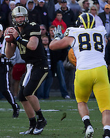 Purdue quarterback Caleb TerBush gets rushed by Michigan defensive end Craig Roh (88) .The Michigan Wolverines defeated the Purdue Boilermakers 44-13 on October 6, 2012 at Ross-Ade Stadium in West Lafayette, Indiana.