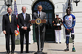 United States President Barack Obama (2R), speaks while Vice President Joe Biden (2L), Secretary of Veterans Affairs Robert McDonald (L)  and Wounded Warrior Williams Reynolds (R) listen during the Wounded Warrior Ride event at the White House, in Washington, DC, April 14, 2016.  The event helps raise awareness to the public about severely injured veterans and provides rehabilitation opportunities. <br /> Credit: Aude Guerrucci / Pool via CNP