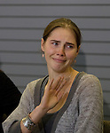 Amanda Knox waves to a group of supporters during a news conference held  at the Seattle-Tacoma International Airport near Seattle, Washington on October 4, 2011. Knox arrived in the United States after departing Rome's Leonardo da Vinci airport,. Knox's life turned around dramatically Monday when an Italian appeals court threw out her conviction in the sexual assault and fatal stabbing of her British roommate.  ©2011. Jim Bryant Photo. All Rights Reserved.